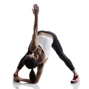 portrait of sport girl doing yoga stretching exercise, studio sh